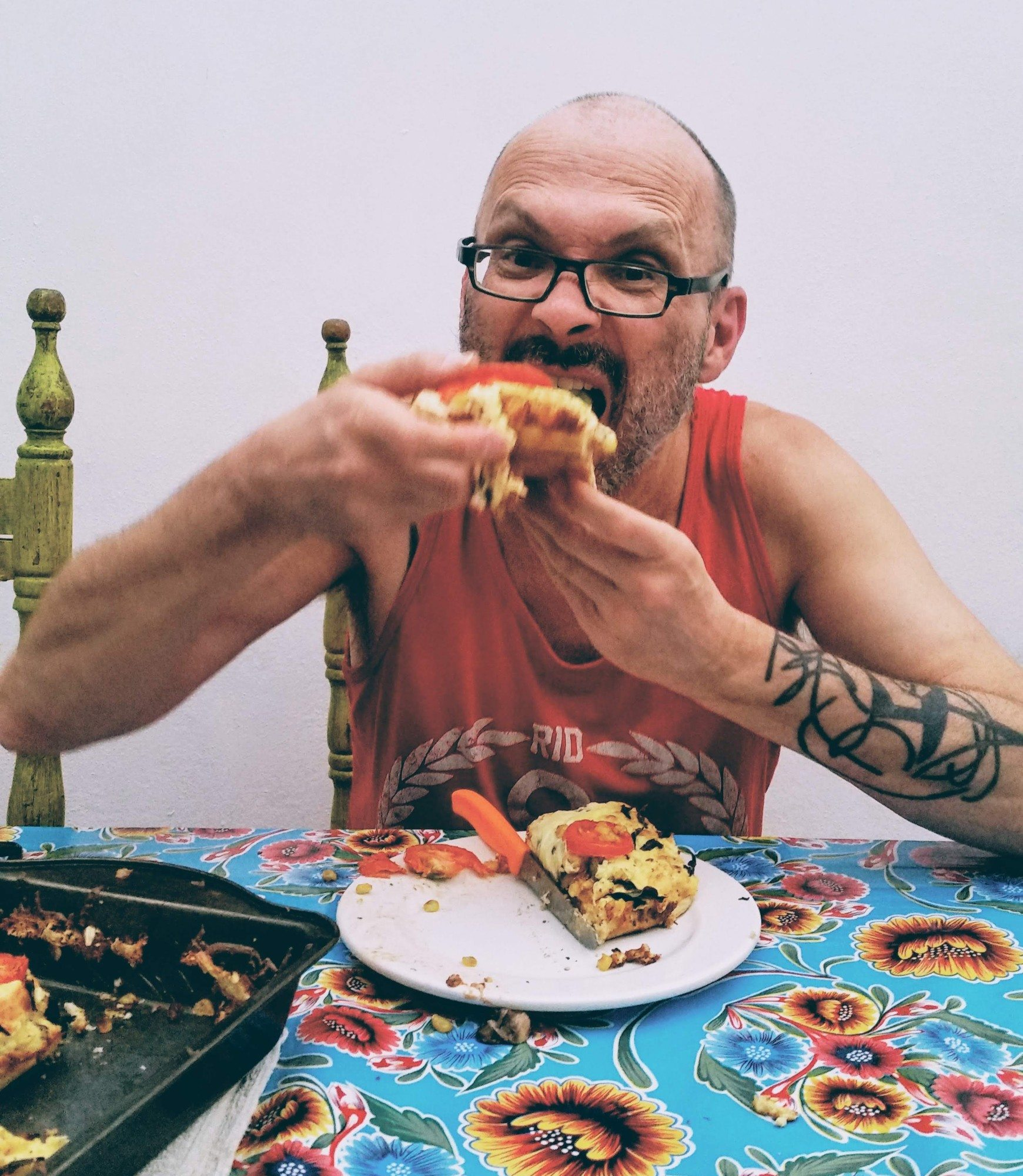 Rick Powell eating his pizza at Hostel Home Mexico City
